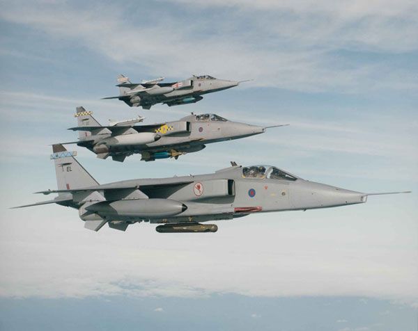 Jaguars of 6, 54 and 41 Squadrons, note the overwing Sidewinder missiles carried on the further tow aircraft, circa 1995 (X003-7115/001/007/003)