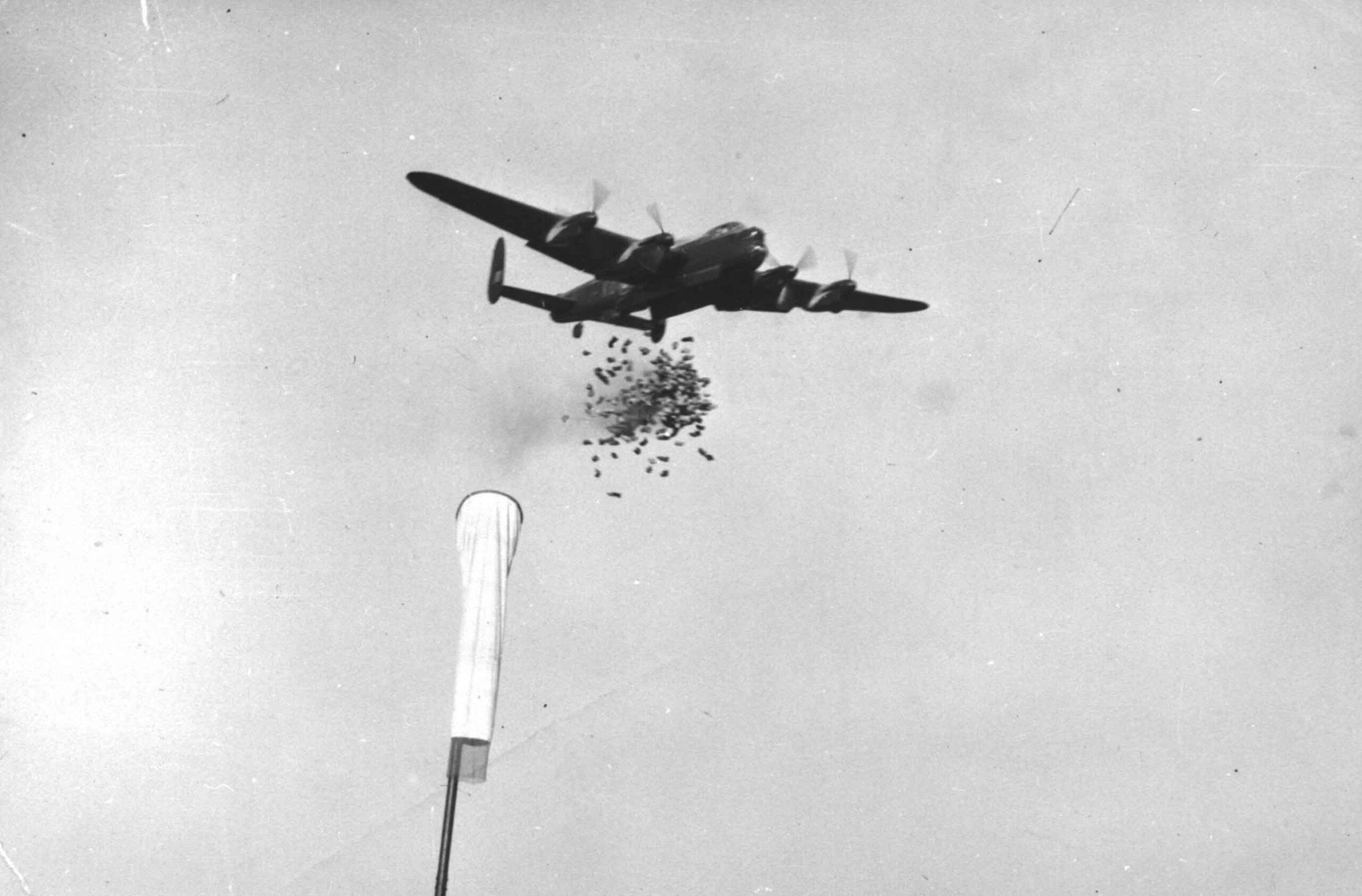 115 Squadron Lancaster doing a practice food drop.