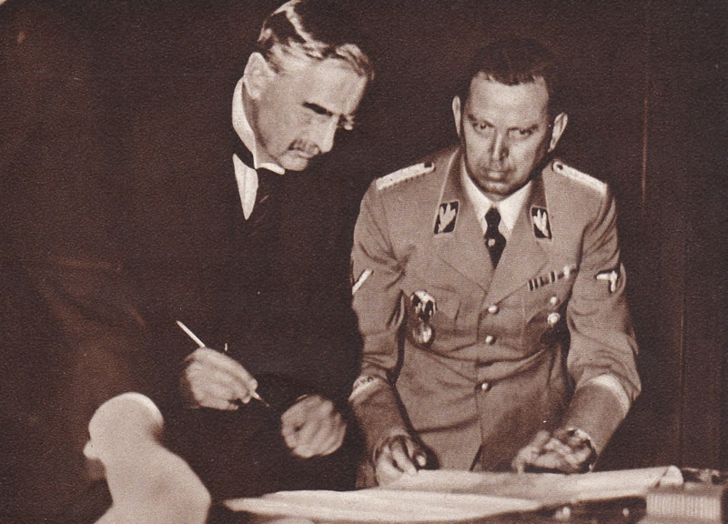 Neville Chamberlain signing the Munich Agreement
