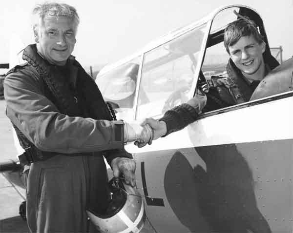 An air cadet of 2386 (Keynsham) Squadron, ATC being congratulated by an instructor, RAF St Mawgan (X003-2603/0055)