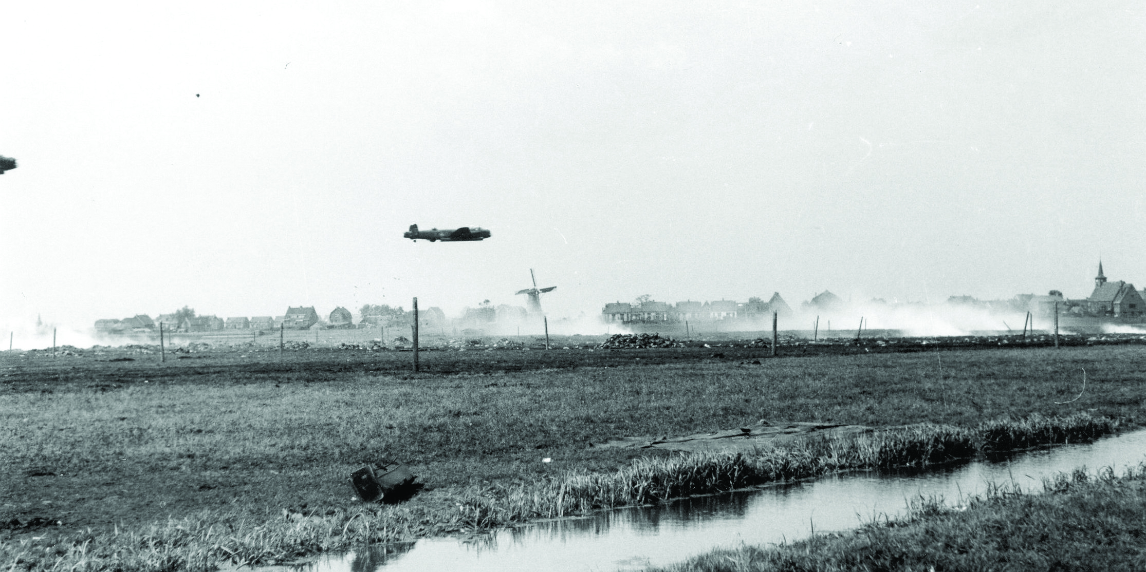 Lancaster at low level over a dropping zone in Holland.