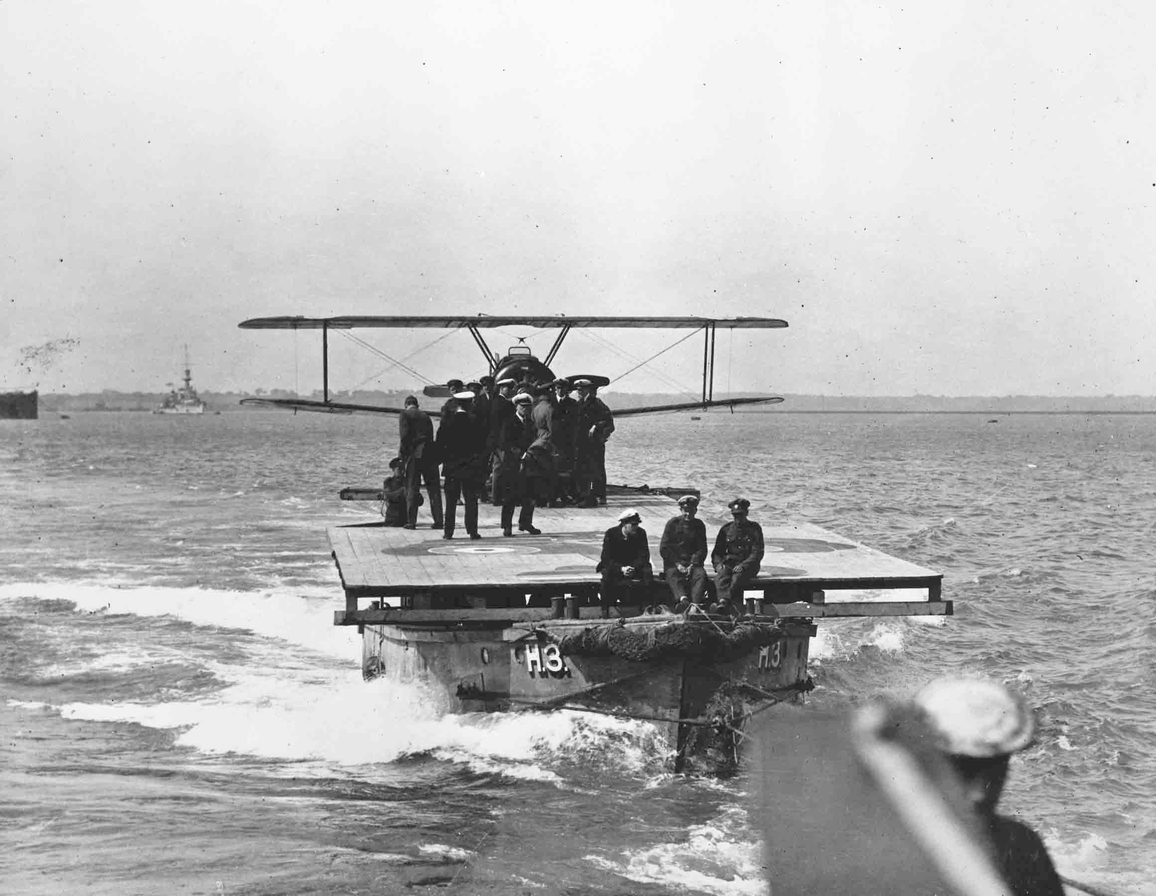 Sopwith 2F1 Camel on board lighter H3 being towed behind a destroyer, Felixstowe, 23 August 1918 (RAFM reference: P015443)
