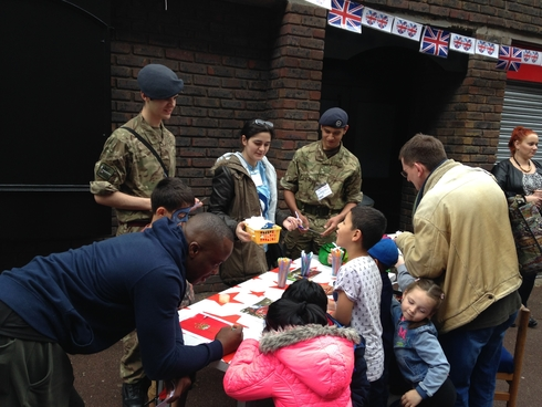 Cadets from 120 Squadron working on a craft table at the Queen's  Birthday Street Party in the Grahame Park Estate