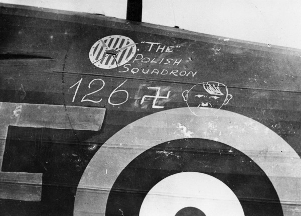 Close up view of port side of a Hawker Hurricane of No.303 Squadron with number of squadron victories marked in chalk