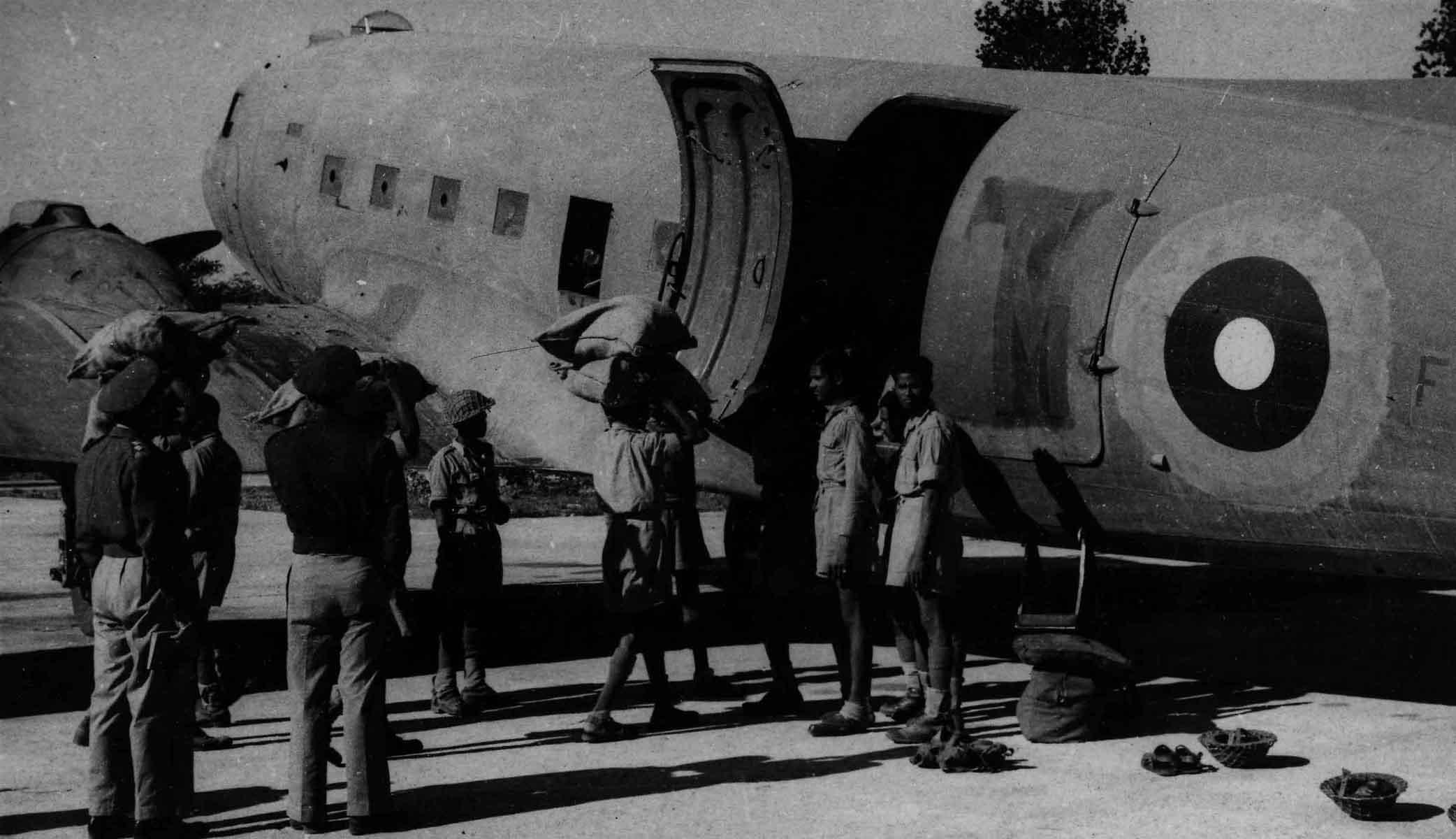 Loading supplies into RAF Douglas Dakota Mk. III, Burma, 10 June 1944 (RAFM PC71/19/608)
