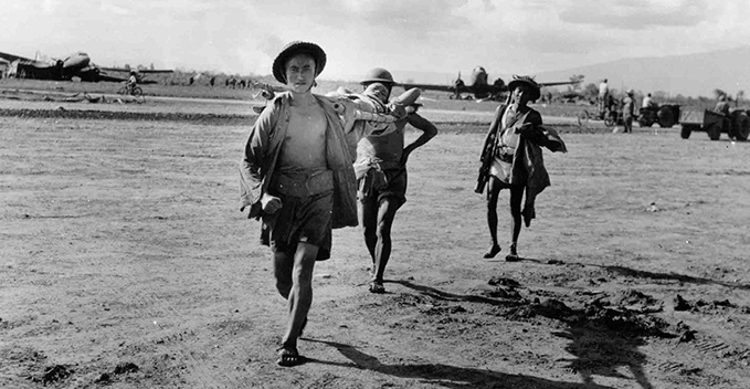 Wounded Chinese soldiers being carried to a Dakota for medical evacuation