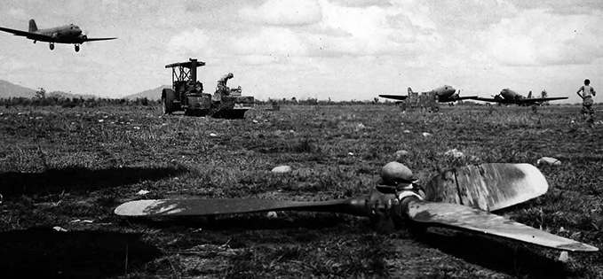 Myitkyina airfield being readied by American engineers while a Dakota comes in the land