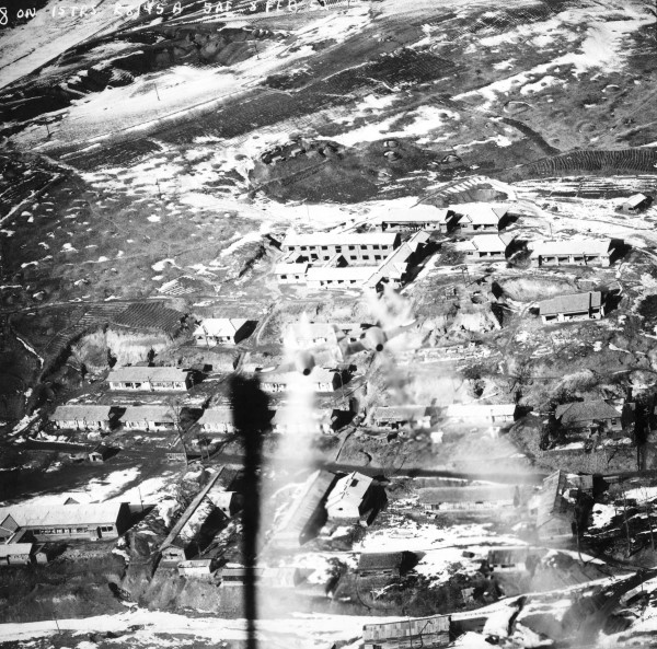 Visible in the centre of the image is the Meteor piloted by Ron Susans making a napalm rocket attack on buildings in North Korea, February 1952 (RAFM AC81/1/2/9)