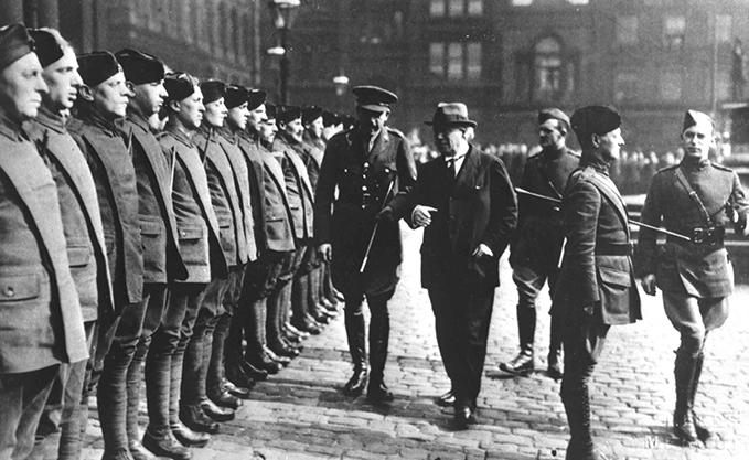 PM Lloyd George (in civilian clothes)