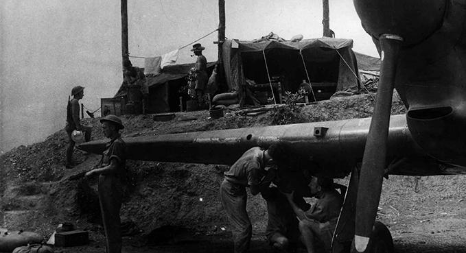 Armourers 'bombing up' a Hurricane in Burma