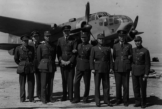 Commonwealth and Chinese aircrew of 5 METS in front of a Beaufort torpedo bomber