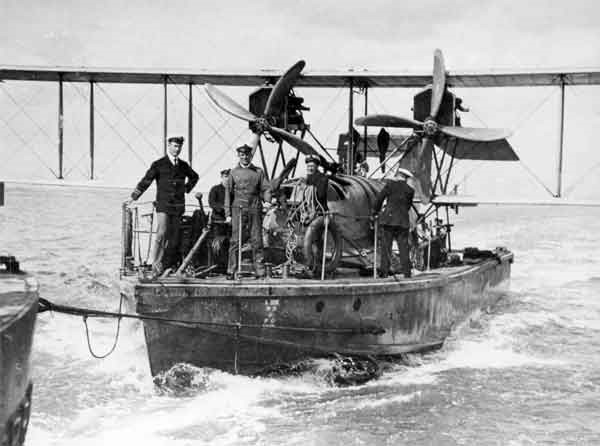 A Curtiss H12 on board a lighter under a short tow. The lighter's bow was designed to prevent spray being thrown over the aircraft's wings at high speed (RAFM reference: X003-2602/6560)