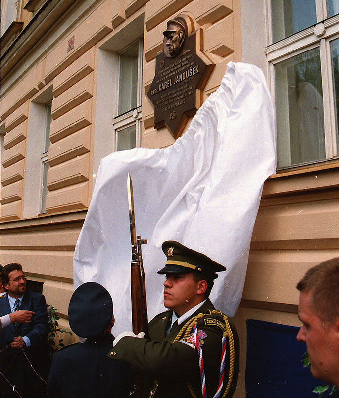 At the same time, memorials were unveiled. Here mention may be made, for example, of the memorial to Czechoslovak airmen honoring the fallen between the years 1939 - 1945, and which is located in Prague's námestí Svobody and implemented by the Association of Czechoslovak Foreign Airmen 1939 - 1945, a plaque for A/M Karel JANOUŠEK, on a house he lived in, in the street U Železné lávky in Prague, a memorial to Czechoslovak airmen in Prostejov, a plaque on the house where W/Cdr Alois VAŠÁTKO, DFC, DSO was born in Celákovice. In the Olšanské hrbitovy, a grave was built for the Czechoslovak former RAF members.