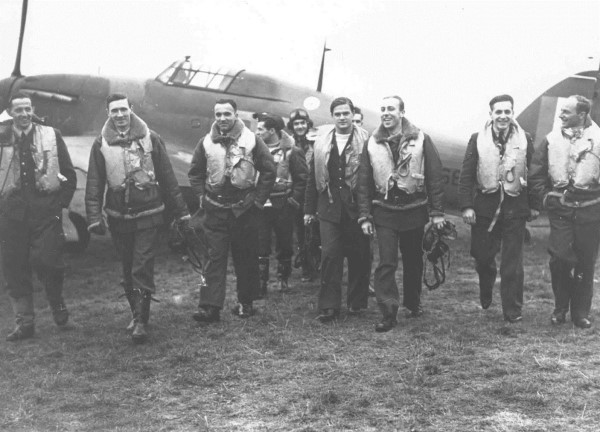 Group portrait of pilots of No.303 Squadron, with Hawker Hurricane in background