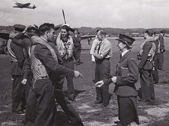Redhill Airbase, 19th August 1942. 310 (Czechoslovak) Squadron at an assembly for the support of the landing at Dieppe – operation Jubilee. From the left: W/Cdr Karel MRÁZEK, DFC, F/Lt Bohuslav KIMLICKA, S/O Dolores ŠPERKOVÁ. Military History Archive.