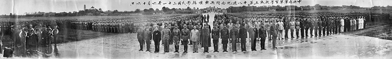 One of the most remarkable photographs in our collection. This image is actually several feet long and shows a large amount of Chinese personnel. In the front row a mixture of British and Chinese personnel.