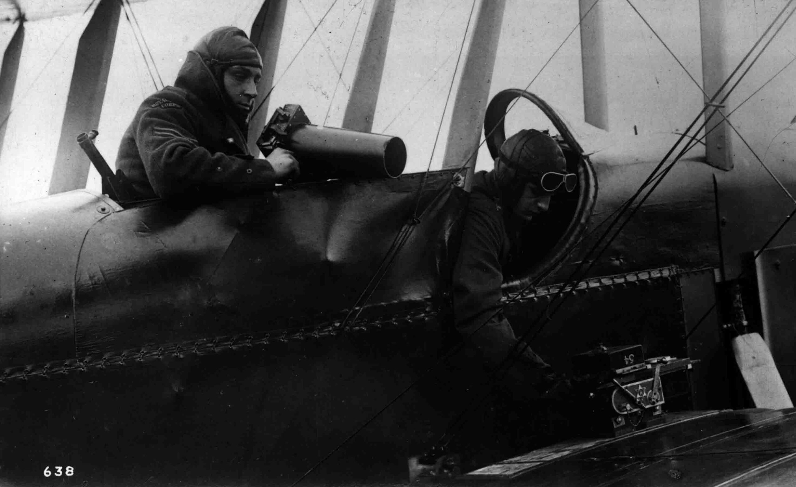 Close up of Armstrong Whitworth FK.3 showing pilot and observer with two types of aerial cameras.