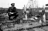Flight Lieutenant Noel Archer of the MRES noting details of aircrew graves at a civilian burial ground in France.