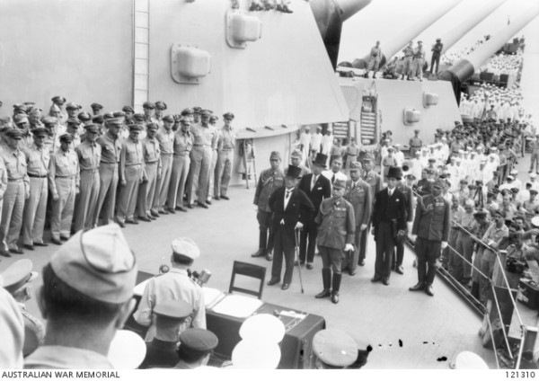 General Douglas MacArthur giving a speech on board the USS Missouri prior to the beginning of the surrender ceremony, 2 September 1945 (AWM 121310)
