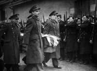 Flt Lt Ralph Laronde and Flt Lt Noel Archer and colleagues from the MRES bearing an exhumed coffin to a reburial ceremony at an official war grave somewhere in France.