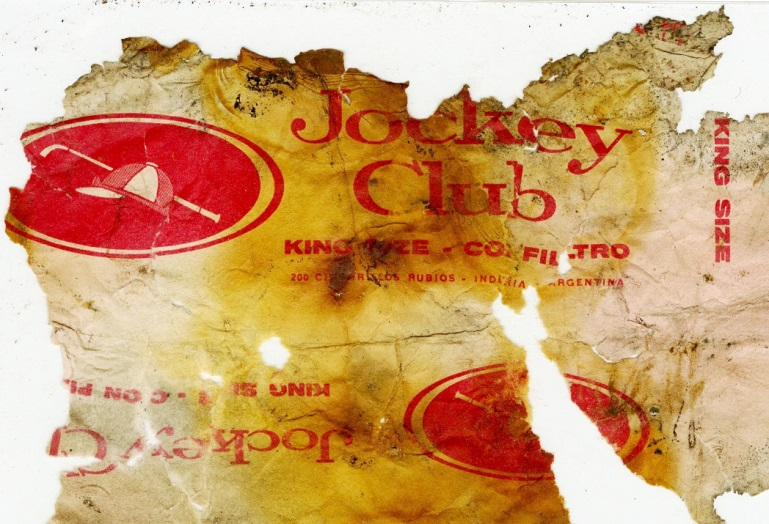 """Burnt remains of this Argentine """"Jockey Club"""" cigarette wrapper was found during conservation work in 2003."""