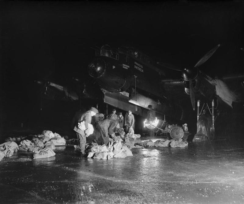 Night loading of food for Holland into an operational Lancaster.