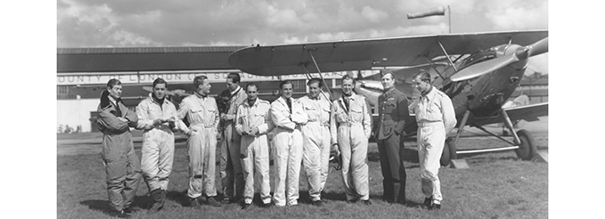 Pilots of 601 Squadron standing in front of Hawker Demons, RAF Hendon, 1938