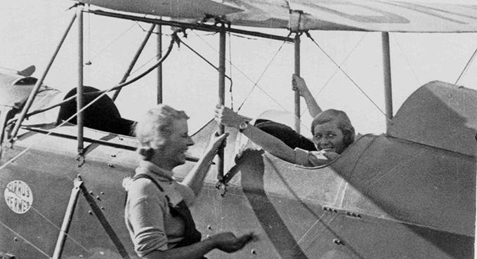Dorothy Spicer (left) talking to Pauline Gower, 1933