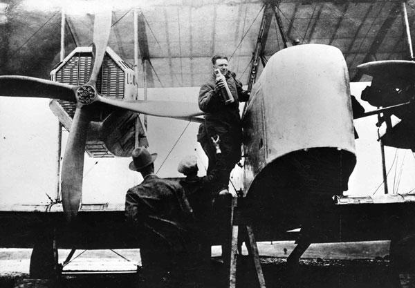 X003-2602/17488: Capt J.W. Alcock boarding aircraft, Lester's Field