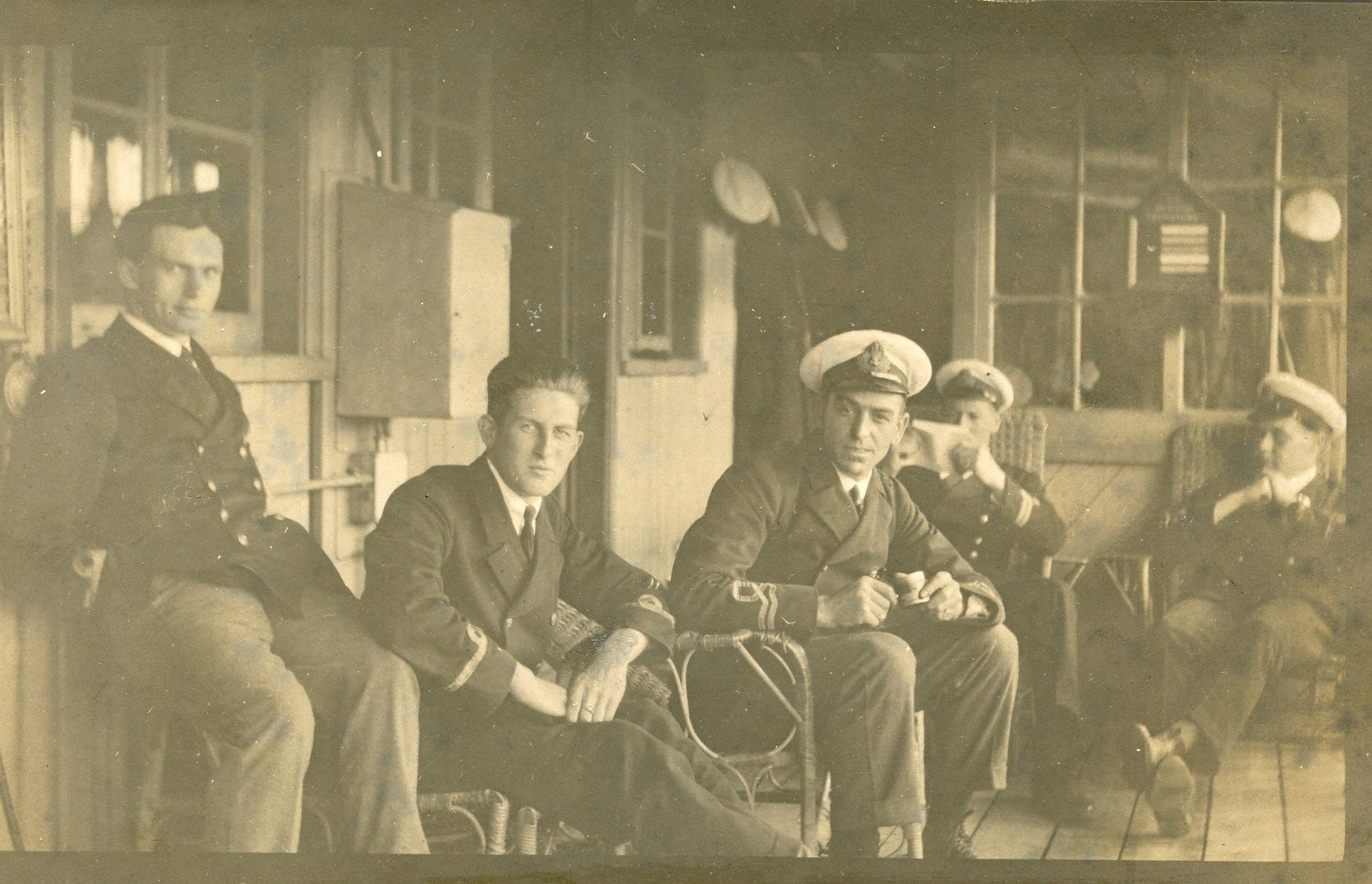 Flight Sub-Lieutenant Cecil John Clayton (left), who led one of the lighter-borne patrols, relaxing with fellow pilots at Felixstowe, 1917. From 'Photograph album of RNAS service at Felixstowe, 1917-1918' compiled by Flight Sub-Lieutenant Edward W Keesey (RAFM reference: B295)