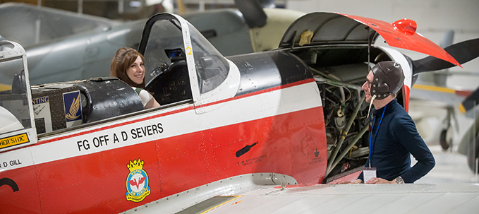 A visitor in the cockpit of the Chipmunk during one of Open Cockpits and Cabs events at the RAF Museum London