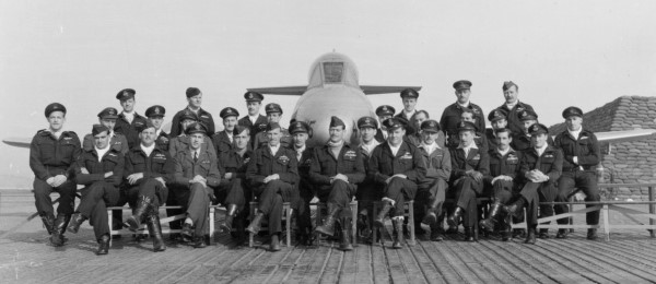 Group portrait of 77 Squadron pilots. RAF excahnge pilots are easily identified by the lighter coloured unifroms worn, Michael Whitworth-Jones is seated front row fifth from the right (RAFM X003-7892)