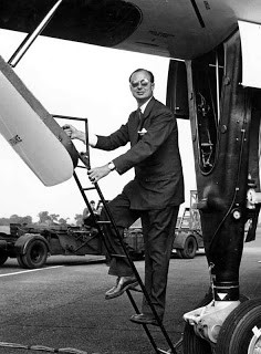 Roly Falk climbing the ladder up to the Vulcan cockpit