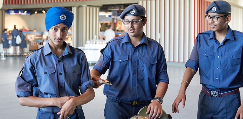 Three young people at the Museum dressed in the uniforms of Air Cadets