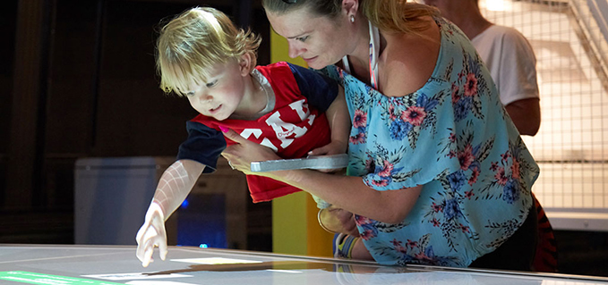 Young visitors interacting with new exhibitions at the RAF Museum London