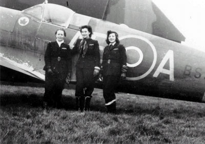 Female pilots with a Spitfire