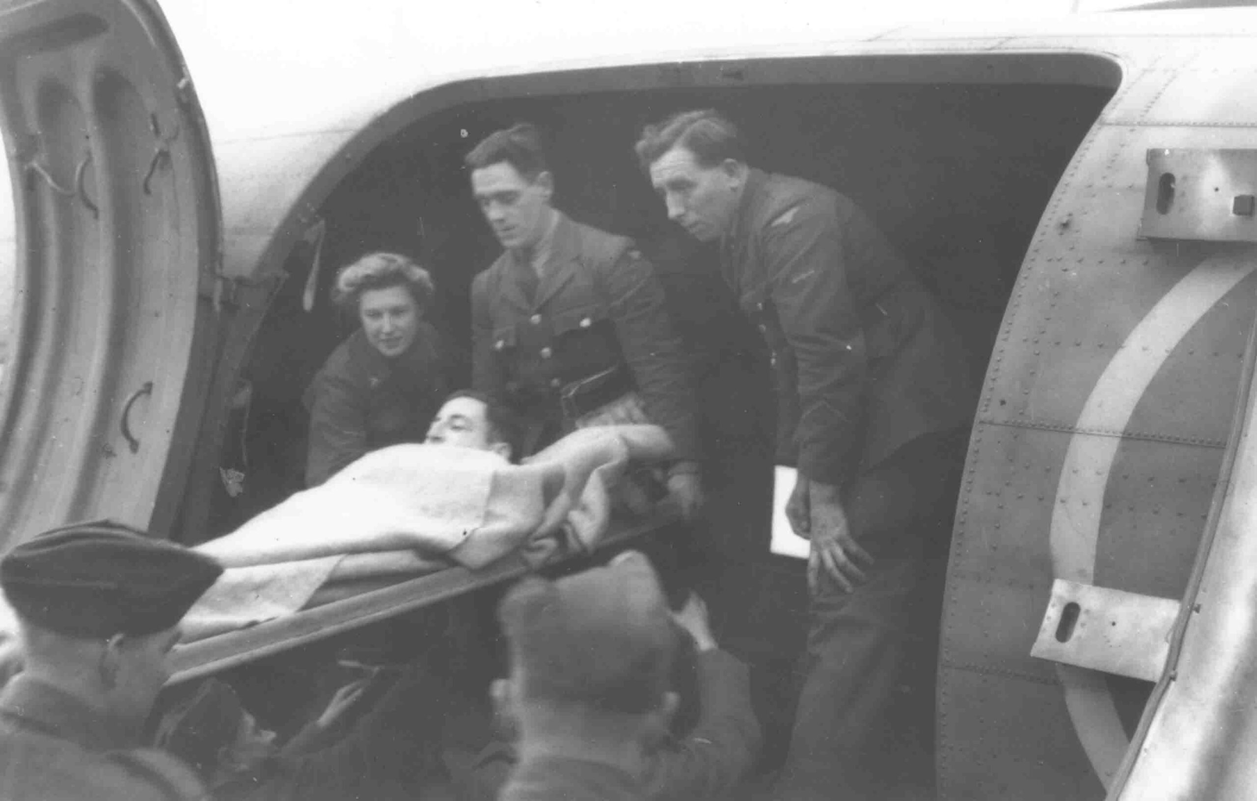 Air Ambulance, unloading wounded soldier from a Dakota. The nurses were often called the Flying Nightingales