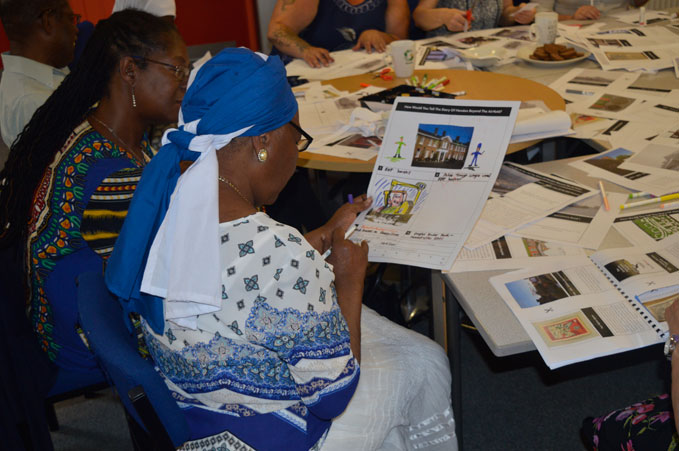 Members of the local community examining themes