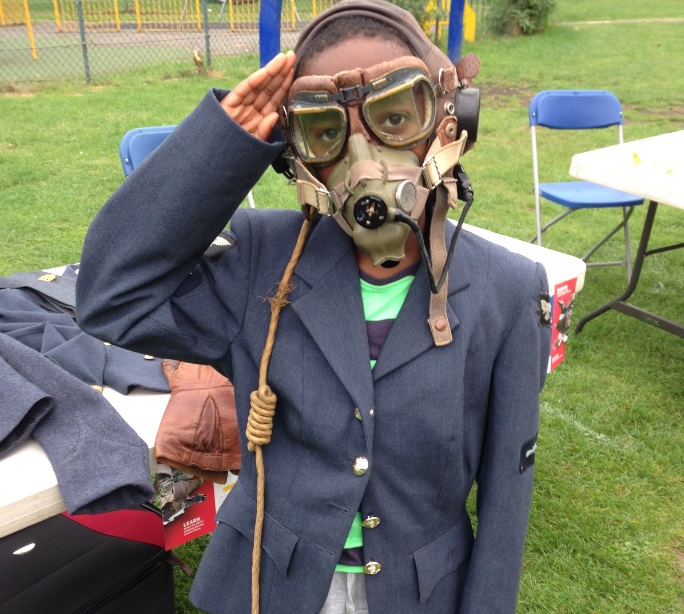 A young member of the community wearing our WW2 Handling Collection