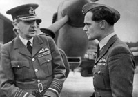 Air Chief Marshal Sir Hugh Dowding, Commander-in-Chief of Fighter Command during the Battle, chats with Bader before the first Battle of Britain flypast, September 1945.