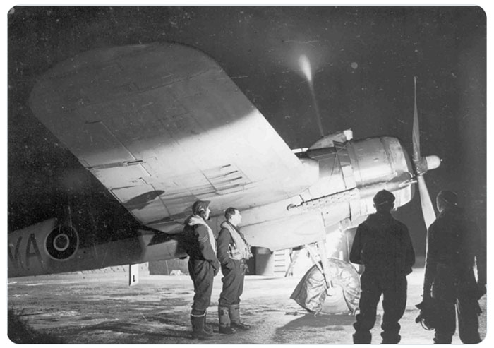 Image showing pilots on a runway at night c1940