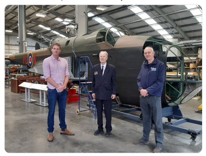 Dan Snow (left), John Watts (Centre) and Darren Priday, Manager of the Sir Michael Beetham Conservation Centre (right) in front of our Hampden, which is in mid-restoration.