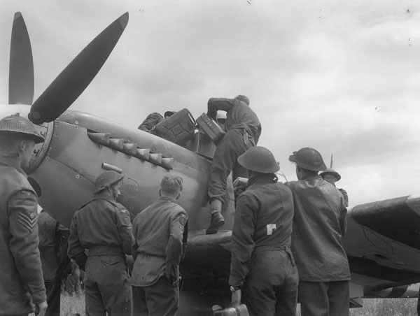 RAF Servicing Commandos showing the simple method to refuel a Spitfire.