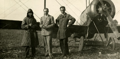 (From left to right) Alan Cobham, Jack Holmes and Fred Holmes standing in front of their Avro 504K biplane while in the Berkshire Aviation Company in 1919.