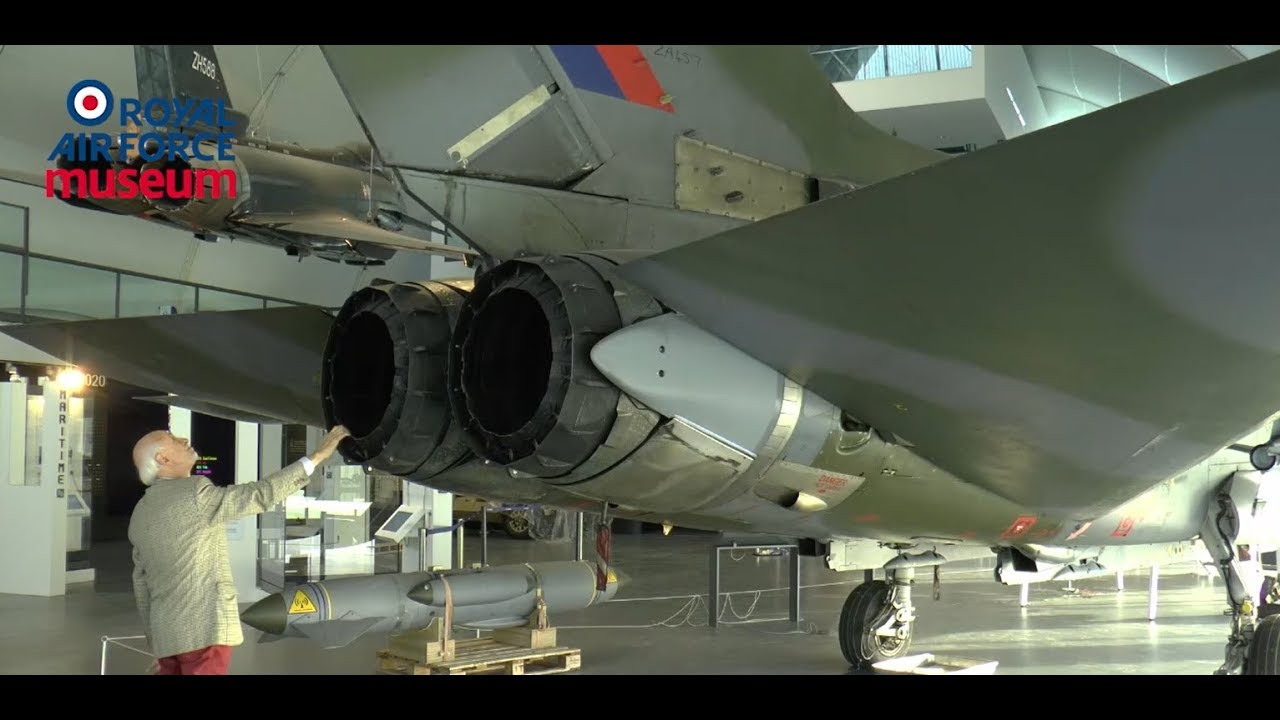 David Eagles examining the engine exhaust of the Tornado