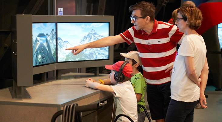A family enjoying one of our new interactives in RAF Stories