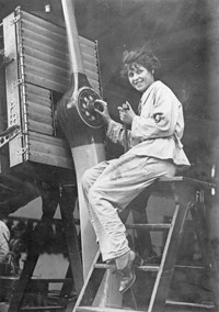Female fitter working on the Liberty engine of a De Havilland D.H.9A