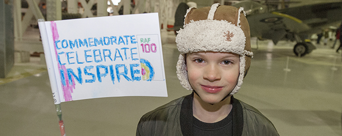 One of our younger visitors being inspired to celebrate the next 100 years