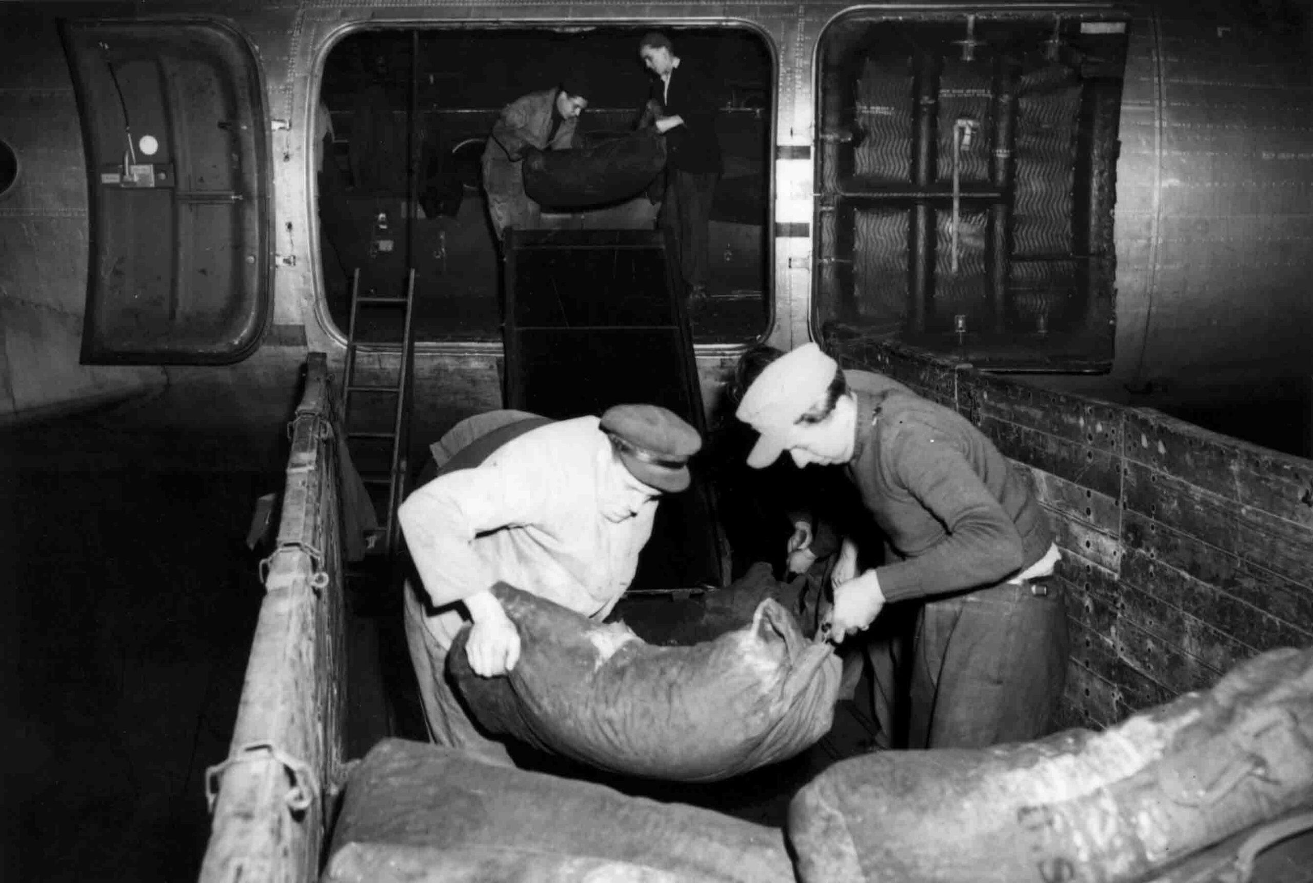 German civilians unloading the Douglas C-54 Skymaster