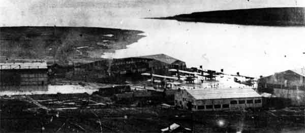 RAF Houton Bay with flying boats visible outside the hangars, c. 1918 (PC97/70/1)